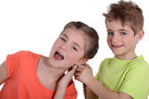 Boy pulling girl's hair — Stock Photo
