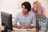 Couple are looking computer — Stock Photo