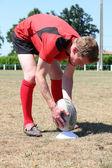 Rugby player döşeme topu — Stok fotoğraf