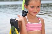 Portret van een klein meisje op het strand — Stockfoto