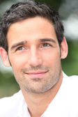 Close-up of dark haired man — Stock Photo