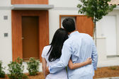 Couple looking at their new home — Stock Photo