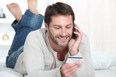 Man topping up phone — Stock Photo