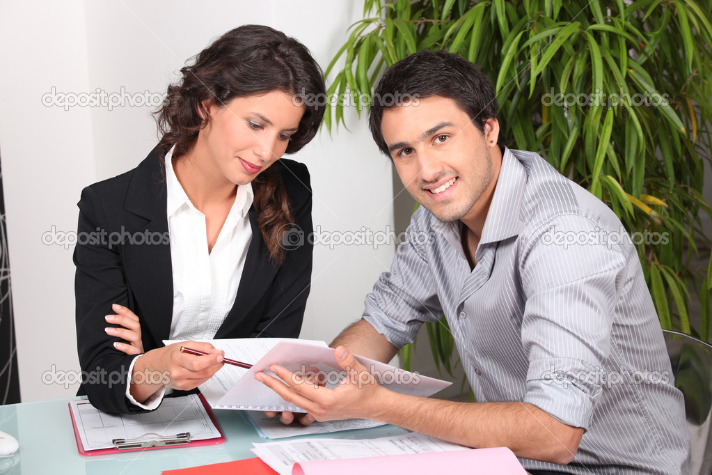 Agent and client discussing a document — Stock Photo #9213964