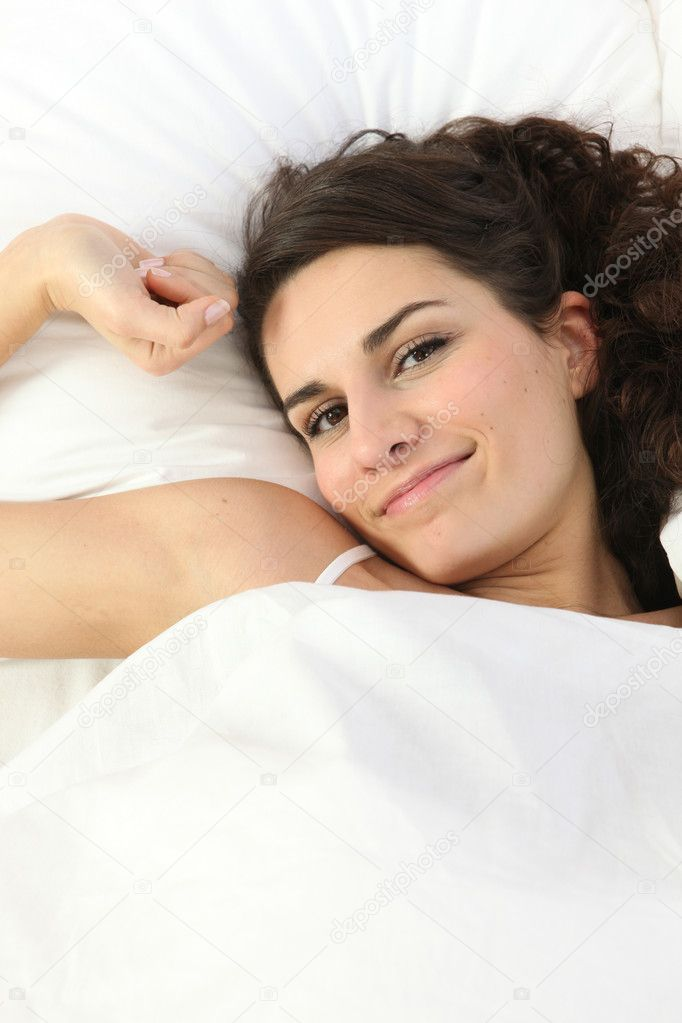 Woman in warm bed — Stock Photo #9217948
