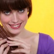 Woman with a bar of chocolate — Stock Photo #9221629