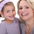 Mother holding daughter in her arms — Stock Photo