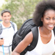 An interracial couple mountain hiking. — Stock Photo #9221755