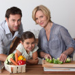 Family in kitchen cooking — Stock Photo
