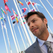 Stock Photo: Businessmwith flags.