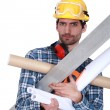 Stock Photo: Handymstruggling to carry his equipment
