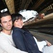 Stock Photo: Young couple waiting for the train
