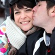 Stock Photo: Couple kissing on ski slopes