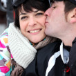 Couple kissing on the ski slopes — Stock Photo