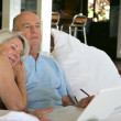 Senior couple relaxing with computer — Stock Photo #9223116