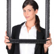 Woman holding empty picture frame — Stock Photo