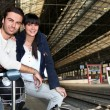 Couple waiting for train — Stock Photo