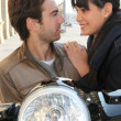 Stock Photo: Couple behind their motorcycle