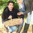 Couple collecting chestnuts — Stock Photo #9225176