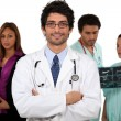 Doctor and his medical team — Stock Photo #9226251