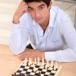 Stock Photo: Boy playing chess