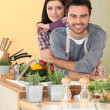 Stock Photo: Couple preparing fresh vegetables