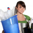 Young woman recycling — Stock Photo