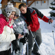 Ski teenagers looking at a phone — Stok fotoğraf