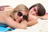 Two teenage girls sunbathing — Stock Photo
