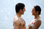 Couple in front of the beach — Stock Photo