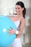 Young woman holding an exercise ball — Stock Photo