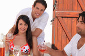 Friends drinking wine in the sunshine — Stock Photo