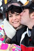 Couple kissing on the ski slopes — Stock Photo