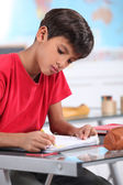 A young Latino studying. — Stock Photo