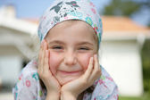 Little girl wearing a bandanna — Stock Photo