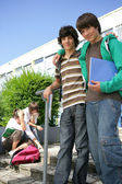 College buddies on campus — Stock Photo