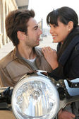 Couple behind their motorcycle — Stock Photo