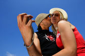 Couple taking self-portrait at the beach — Stock Photo
