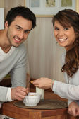 Young couple sharing a bowl of cornflakes — Stock Photo