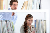 Couple stood in library — Stock Photo
