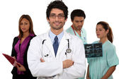 Doctor and his medical team — Stock Photo