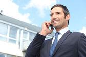 Businessman using a cellphone — Stock Photo