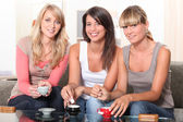 Portrait of three women at teatime — Stock Photo