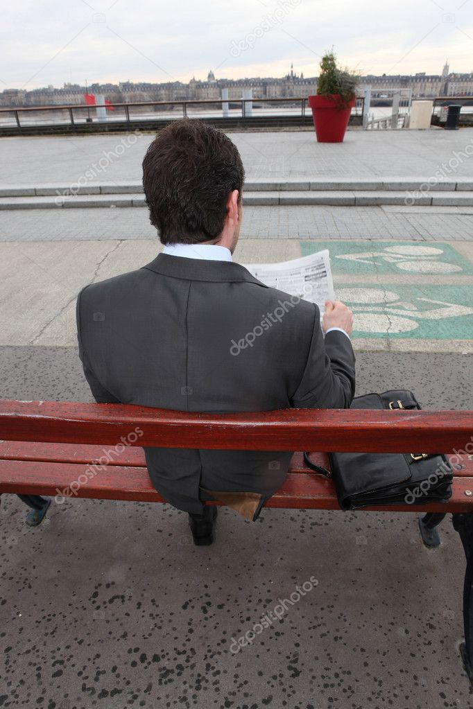 Man sitting on a bank — Stock Photo #9226304