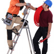 Stock Photo: Two electrician stood with step-ladder