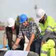 Construction workers looking at site plans — Stock Photo #9231678