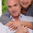 Foto Stock: Parents hugging
