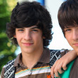 Stock Photo: Two teenagers posing