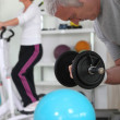 Royalty-Free Stock Photo: Older couple working out in gym