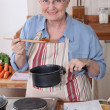 Grandmother cooking. — Stock Photo